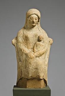 Statuette af en siddende kvinde med et barn. Vestgræsk