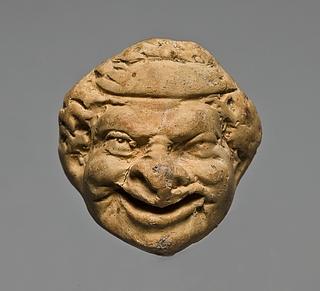 Miniaturehoved med teatermaske. Vestgræsk