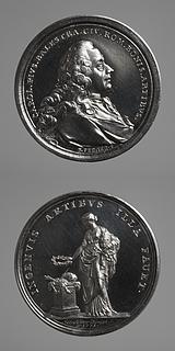 Medalje forside: Arkitekten Carlo Pio Balestra. Medalje bagside: Pavemagten rækker en laurbærkrans over et alter med kunstarternes attributter