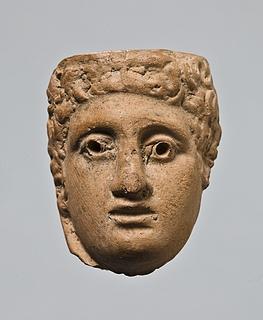 Appliqué (?) i form af et mandshoved. Romersk