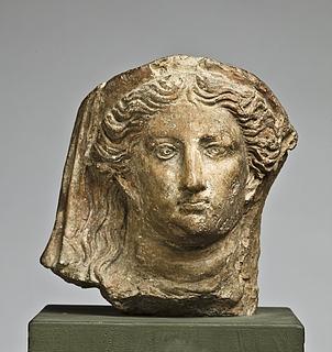 Antefiks i form af et kvindehoved. Romersk
