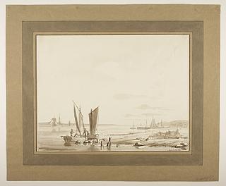 Strandbred med fiskerbåde