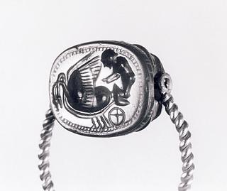 Apollon på en vogn trukket af to svaner. Etruskisk skarabæ