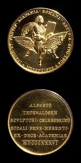 Medalje forside: Lukas. Medalje bagside: Indskrift