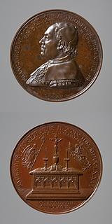 Medalje forside: Biskop Lock fra Antiokia. Medalje bagside: To engle med bispedømmets insignier svæver over et alter