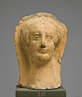 Votivhoved af en kvinde (?). Etruskisk-romersk
