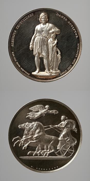 Medalje forside: Bertel Thorvaldsen med Håbets gudinde. Medalje bagside: Victoria nærmer sig en sejrende quadriga