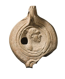Lampe med en mandlig buste. Romersk