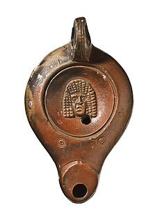 Lampe med en tragisk maske. Romersk