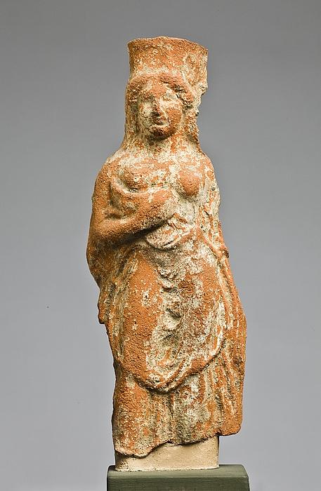 Statuette af en kvinde med en gris. Vestgræsk