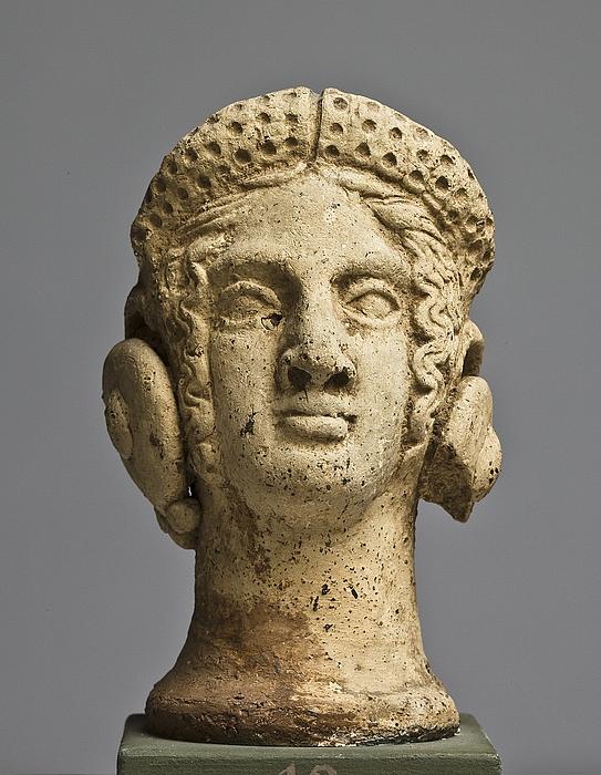 Votivhoved af en kvinde. Etruskisk