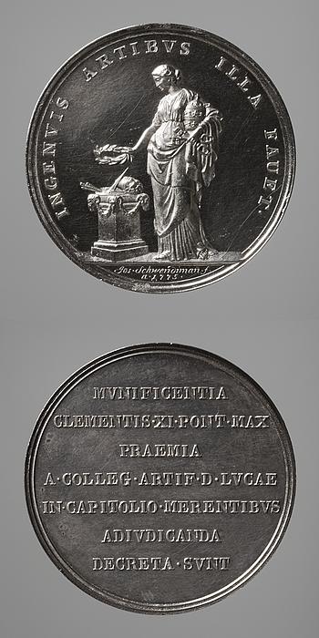 Medalje forside: Pavemagten rækker en laurbærkrans over et alter med kunstarternes attributter. Medalje bagside: Inskription