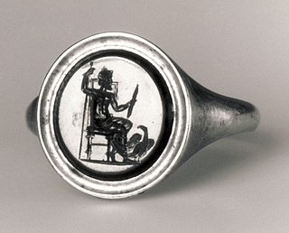 Zeus siddende med tordenkile, scepter og ørn. Hellenistisk-romersk ringsten