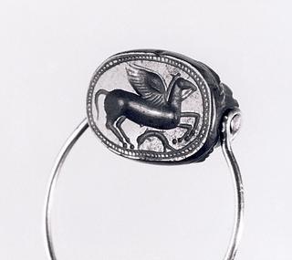 Bevinget hest. Etruskisk skarabæ