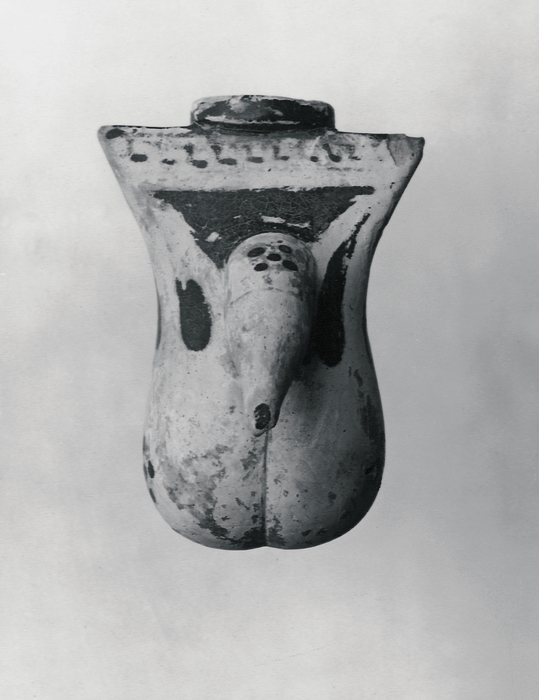 Alabastron i form af mandligt genitalieparti. Græsk korinthisk