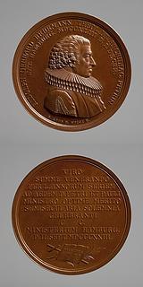 Medalje forside: Rudolph Gerhard Behrmann. Medalje bagside: Kors, palmegren og Den Hellige Skrift