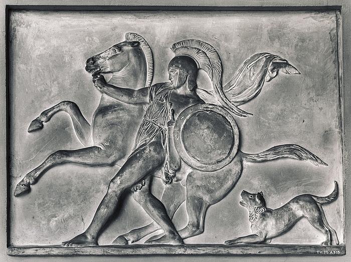 Kriger fører en hest