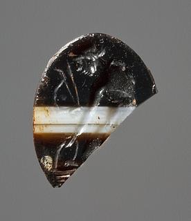 Apollon med bue, pil og en cista. Romersk republikansk ringsten