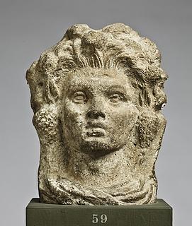 Antefiks i form af et satyrhoved. Etruskisk-italisk