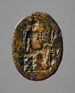 Demeter, siddende med kornaks og en myre. Romersk ringsten