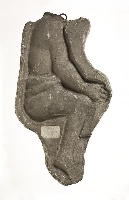 Sidende figur