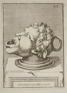 Lampe i form af et mandshoved med en vinranke i håret