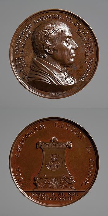 Medalje forside: Frimureren Guionneau. Medalje bagside: Brændende alter med tre glober
