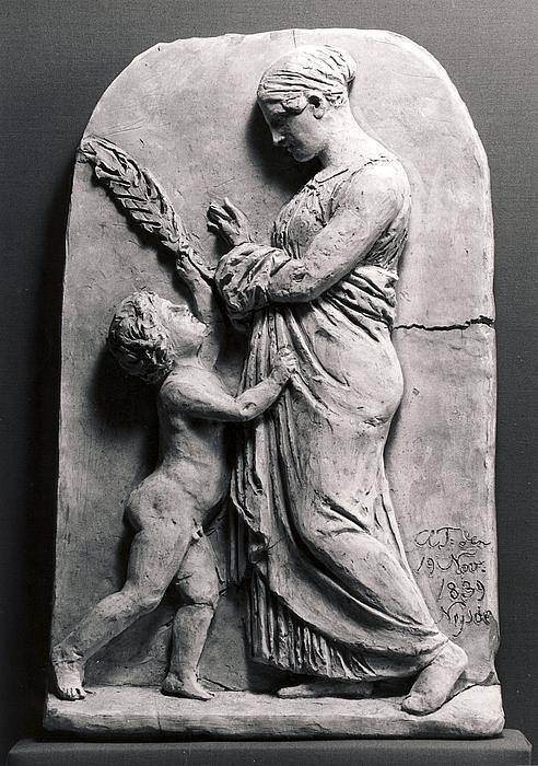 En kvinde og en dreng med palmegren