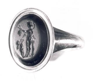 Eros og en satyr med drueklase og hyrdestav. Hellenistisk-romersk ringsten