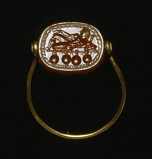 Herakles liggende p? en t?mmerfl?de. Etruskisk skarab?