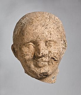 Skulptur af en mand. Etruskisk