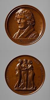 Medalje forside: Portræt af Thorvaldsen. Medalje bagside: Gratierne og Amor