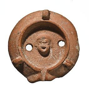 Lampe med en komisk maske. Romersk
