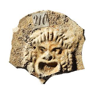 Lampe (?) med en komisk maske. Romersk
