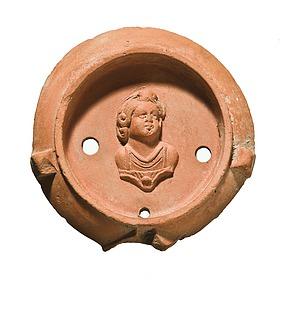 Lampe med buste af et barn (Amor?). Romersk