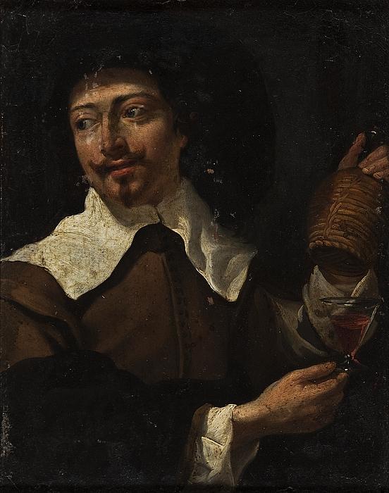 En mand med et vinglas