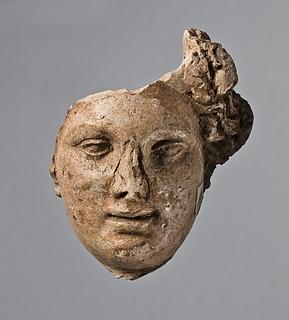 Relief (?) med et kvindehoved. Romersk