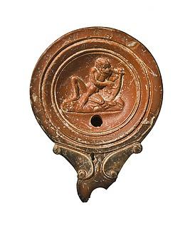 Lampe med afrikansk (?) mand, der spiller på lyre. Romersk