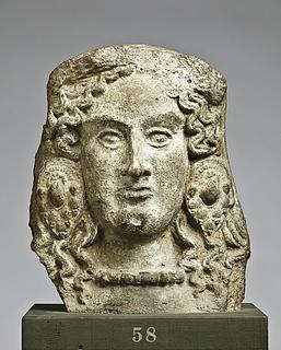 Antefiks i form af mænadehoved. Etruskisk