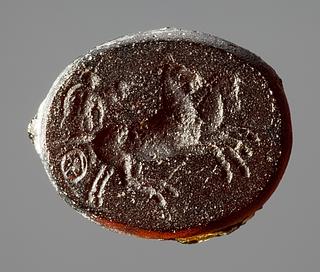 Kriger og vognfører på en vogn med tospand. Hellenistisk-romersk paste