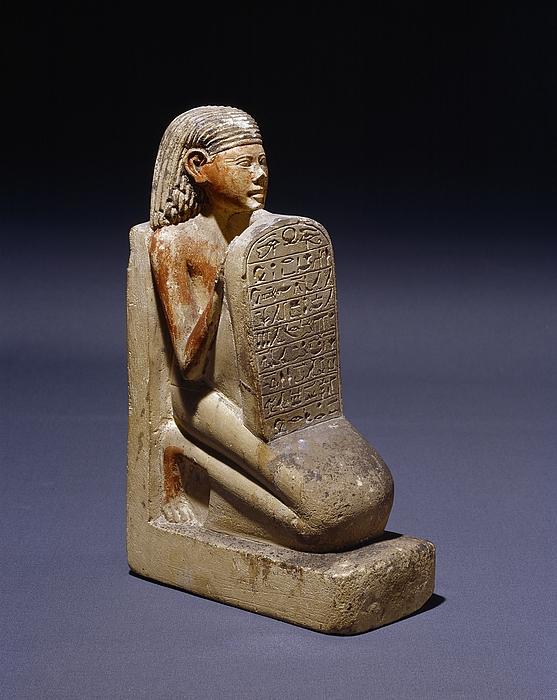 Statuette af en knælende mand med en stele. Ægyptisk, attende dynasti