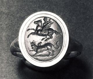 Bellerofon på Pegasus, i kamp mod kimæren. Hellenistisk-romersk ringsten