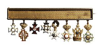 Guldplade med otte miniatureordener