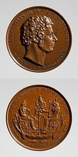 Medalje forside: Naturforskeren Lorenz Oken. Medalje bagside: Osiris og Isis rækker hinanden livets tegn