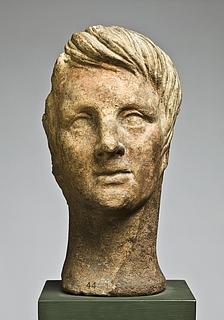 Votivhoved af yngling. Etruskisk