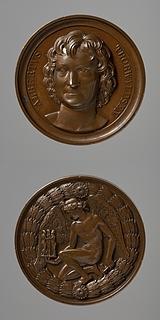 Medalje forside: Portræt af Thorvaldsen. Medalje bagside: Billedhuggerkunstens genius knæler med Thorvaldsens Gratierne og Amor i hånden