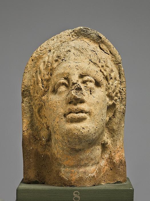 Votivhoved af en kvinde. Etruskisk-romersk