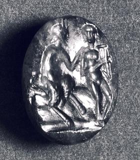 Pan lærer Dafnis at spille på panfløjte. Hellenistisk-romersk ringsten